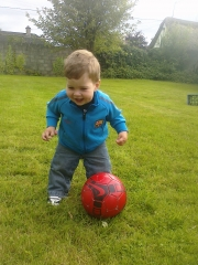 Having so much football fun he\'s going to fall over laughing